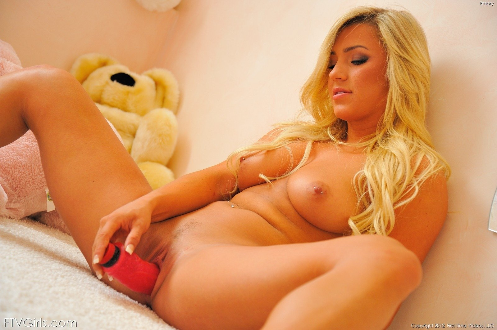 Beautiful babe uses vibrators before taking two cocks in bed