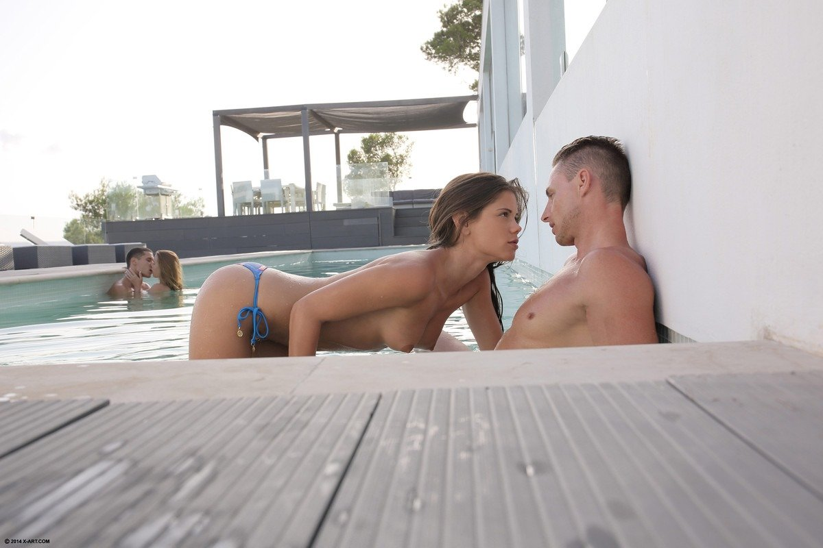 Two Couples Blowing In The Pool